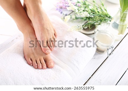 Sugar paste, care of female legs. Beautiful feet of a woman during treatments. - stock photo