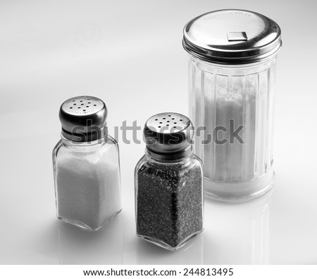 Sugar, salt, and pepper shakers. - stock photo