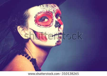 Sugar skull girl in hat halloween concept Fashion retro toning. - stock photo