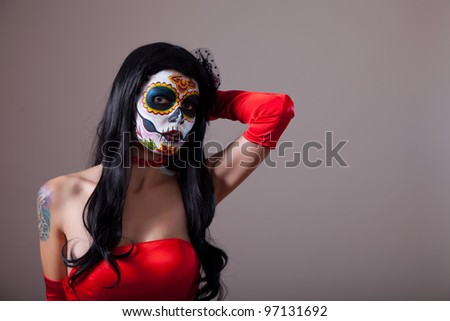 Sugar skull girl in red dress, copy-space for your text - stock photo