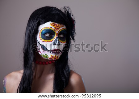 Sugar skull girl portrait, studio shot - stock photo