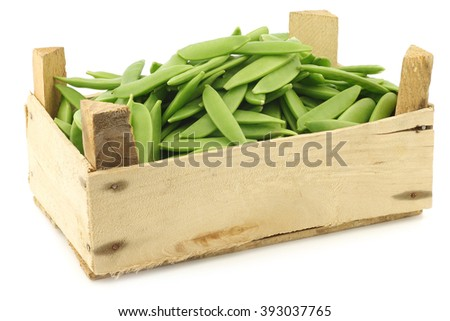sugar snaps in a wooden crate on a white background - stock photo