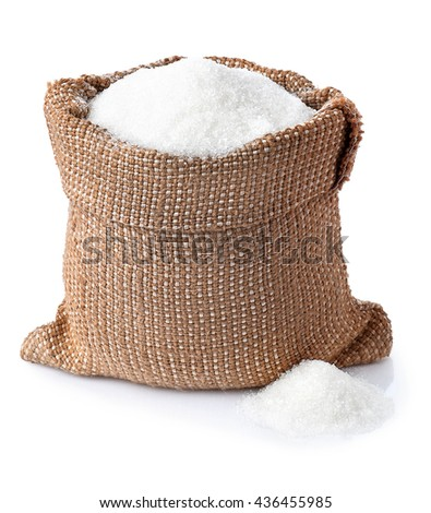 Sugar. Sugar in burlap sack isolated on white background. Full bag of sugar crystals closeup - stock photo