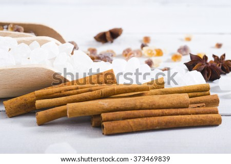 sugar variations with cinnamon and vanilla on white wood table background