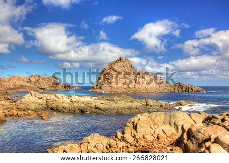 Sugarloaf Rock is a coastal landmark near the town of Dunsborough in South-West Australia. The rock is the world's most southerly nesting site for the Red-Tailed Tropic Bird. HDR image. - stock photo