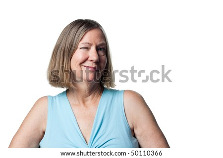 Suggestive wink from an attractive older woman - stock photo