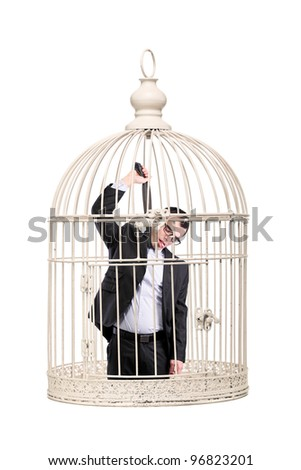 suicidal business man locked in a cage - stock photo