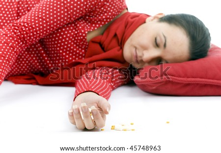 suicide test -  young depressive woman lying on red pillow - stock photo
