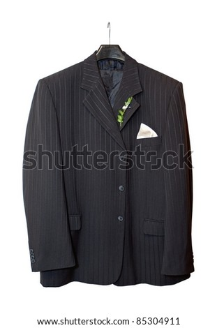Suit jacket hanging on a hanger with a boutonniere in place on white background
