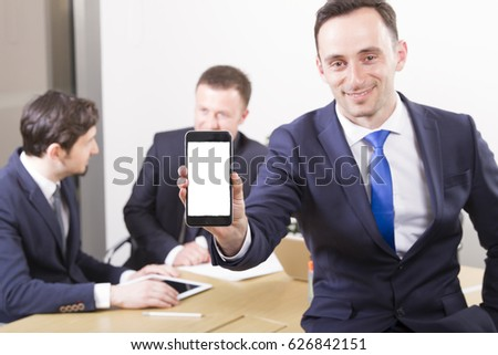 Suit up Young Businessman Holding Smart phone with Blank Screen