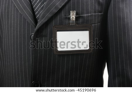 suit with blank id card - stock photo