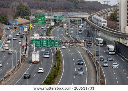SUITA, JAPAN - MARCH 9: Chugoku Expressway, one of the busiest highways in Japan on March 9, 2014 in Suita. It connects Kansai and Chugoku including major cities of Hiroshima, Kobe, and Osaka. - stock photo
