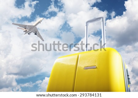 suitcase and airplane - stock photo