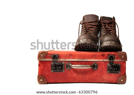 suitcase and boots  isolated on white background - stock photo