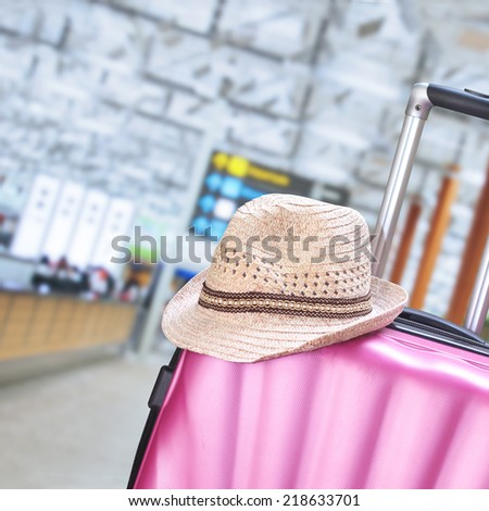 suitcase and hat  - stock photo