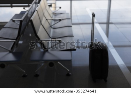 suitcase at the airport blurred image, nobody
