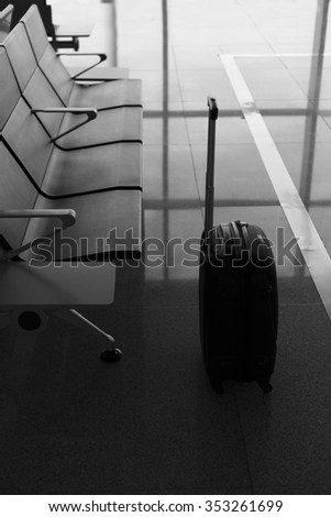 suitcase at the airport, nobody