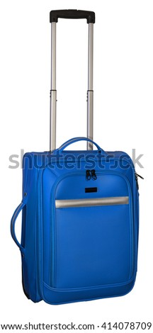Suitcase for travel. Blue color with silver accents. Extendable handle fully extended. - stock photo