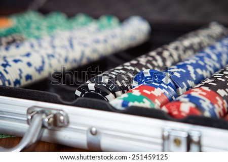 Suitcase full of Poker Chips  - stock photo