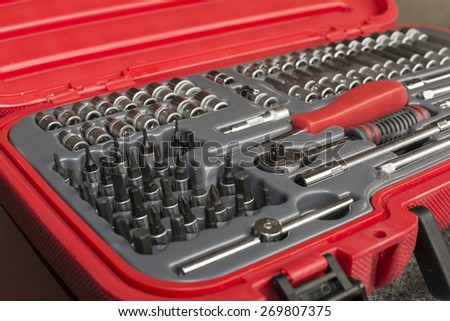Suitcase full of various tools. - stock photo