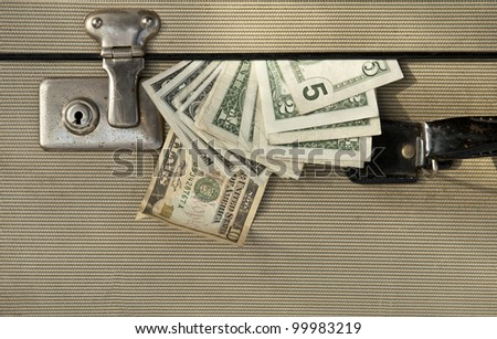Suitcase full with money. - stock photo