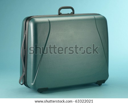 suitcase isolated on a blue background - stock photo