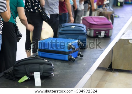 Suitcase On Luggage Conveyor Belt Baggage Stock Photo