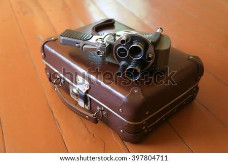 suitcase on the floor, retro style,Camera - Photographic Equipment, - stock photo