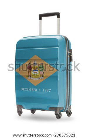 Suitcase painted into US state flag - Delaware - stock photo