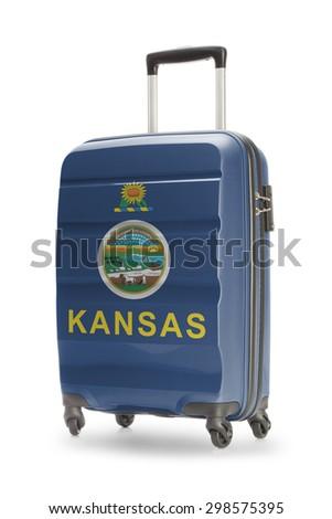 Suitcase painted into US state flag - Kansas - stock photo