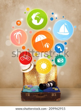 Suitcase with colorful summer icons and symbols on grungy background - stock photo