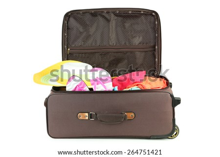 Suitcase with full of clothes - stock photo