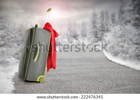 suitcase with red towel on road  - stock photo