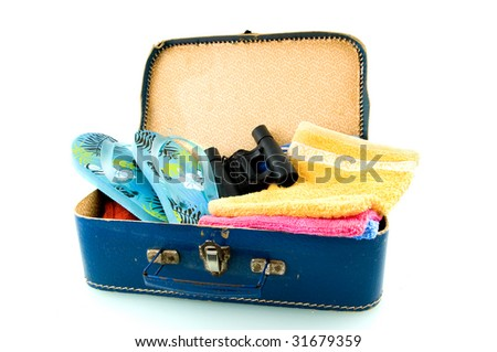 Suitcase with sandals, field-glasses and towels on white background - stock photo