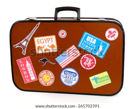 Suitcase with stickers isolated on white - stock photo