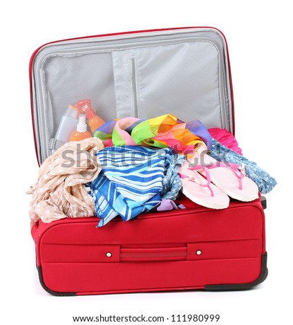 Suitcase with summer clothes, a hat and suntan isolated on white - stock photo