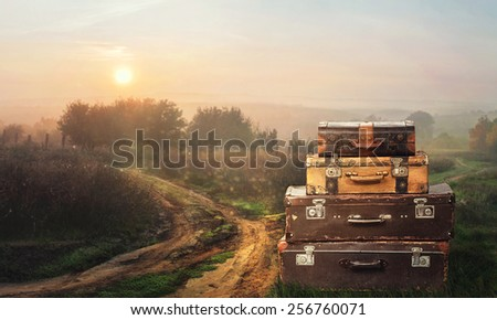 Suitcases and a long road - stock photo