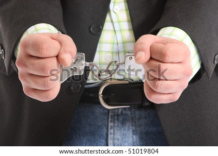 suited guy in handcuffs