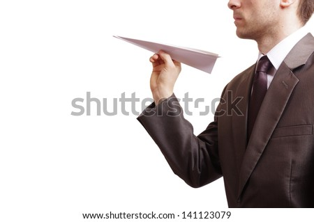 suited man holding a paper plane - stock photo