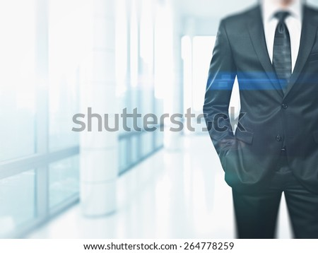 Suited man in the bright office with special effects
