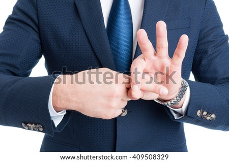 Suited man making sexual finger in the hole gesture as sex request concept - stock photo