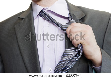 suited man tearing off his tie on white background