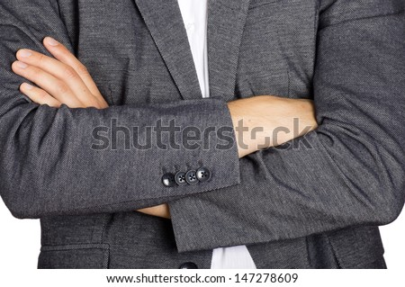 suited man with arms crossed in front