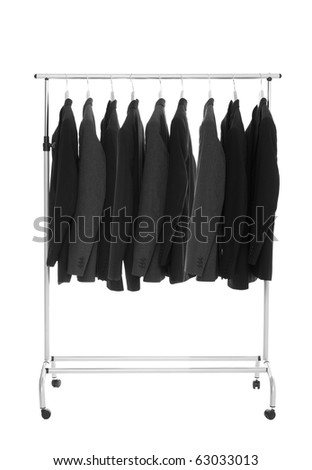 Suits on a Dress Rack isolated on white background - stock photo