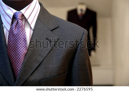 Suits on shop mannequins. - stock photo