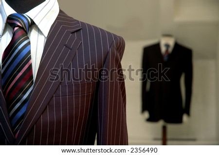 Suits on shop mannequins display. - stock photo
