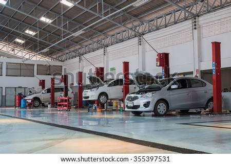SUKHOTHAI - DECEMBER 26:mechanic Mitsubishi car maintenance services car at MItsubishi Motor Service station on December 26, 2015 in Sukhothai, Thailand. - stock photo