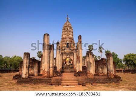 Sukhothai ruin old pagoda against blue sky at Wat Phra Sri Rattana Mahathat in Si Satchanalai historical park, Thailand - stock photo
