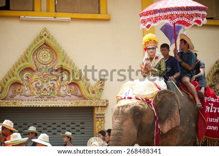 SUKHOTHAI,THAILAND - APR 7 :  Buat Chang Hat Siao held annually a features  spectacular procession of ordination in colorful costumer on the backs of  elephants on April 7,2015 in Sukhothai,Thailand.  - stock photo
