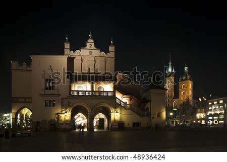 Sukiennica and Mariacky church in Krakow at night - stock photo